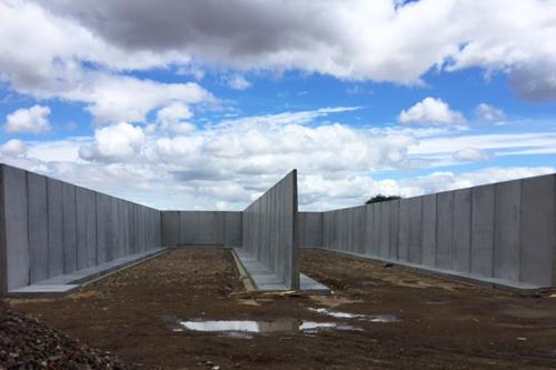 Precast concrete T-retaining walls